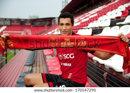 NONTHABURI-THAILAND JANUARY 8: Jay Bothroyd footballer from England pose with scarf  his press conference as a new player for SCG Muangthong United at SCG Stadium on January 8, 2014 in,Thailand - stock photo