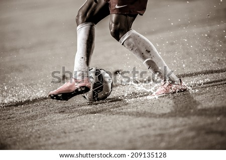NONTHABURI THAILAND-Jul30:Football being kicked on lawn during the LFP World Challenge 2014 between SCG Muangthong UTD. and Almeria at SCG Stadium on July30,2014,Thailand - stock photo