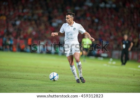 NONTHABURI,THAILAND-JULY 24 : Bernardino's Luis Santo player of  Buriram United in action during between SCG Muangthong United (R) and Buriram FC (W) at SCG Stadium on July 24, 2016 in,Thailand.