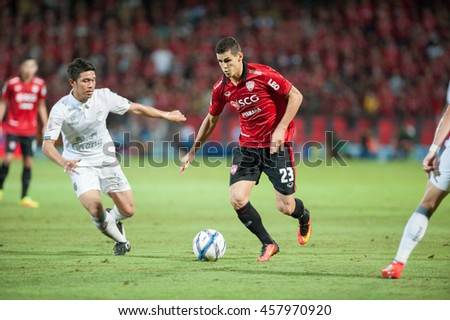 NONTHABURI,THAILAND-JULY 24 : Cleiton Silva player of SCG Muangthong United in action during the game between SCG Muangthong United (R) and Buriram FC (W) at SCG Stadium on July 24, 2016 in,Thailand. - stock photo