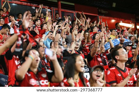 NONTHABURI,THAILAND-JULY 15: The fan club of MTUTD put their hand up and cheer between the game SCG Mungthong United and Rachaburi Mitrpol F.C. at SCG Mungthong Stadium on July 15, 2015 in,Thailand.