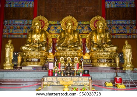 Nonthaburi, Thailand - July 9, 2016: Three Golden Buddha statues for pray or make merit for the happiness life at Wat Borom Raja Kanjanapisek or Wat Leng Nei Yi 2, The traditional Chinese temple