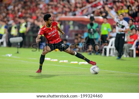 NONTHABURI THAILAND-JUN14:Weerawut Kayem of SCG MUTU. the ball during a Thai Premier League between SCG Muangthong Utd and Osotspa M-150 Saraburi F.C. at SCG Stadium on June 14,2014,Thailand - stock photo