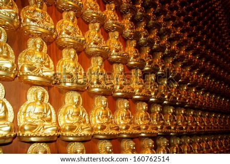 NONTHABURI-THAILAND-JUNE 7 : DOF of Many Golden Buddha statue in Chinese temple, Buddha is the worship of Thai Buddhist on June 7 2013, Nonthaburi Province, Thailand