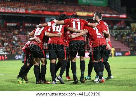 NONTHABURI,THAILAND-June 22 : SCG Muangthong United players celebrate after finish score during the game between SCG Muangthong United and Osotspa FC at SCG Stadium on June 22, 2016 in,Thailand. - stock photo