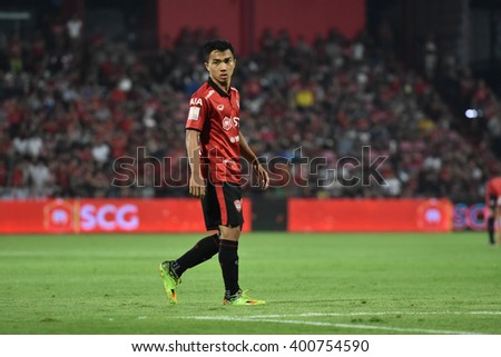 NONTHABURI-THAILAND MAR9:Chanathip Songkrasin of Muangthong Utd in action during Thai Premier League 2016 Muangthong Utd and Bangkok Glass FC at SCG Stadium on March 9,2016 in Nonthaburi,Thailand - stock photo