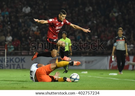 NONTHABURI-THAILAND MAR9:Cleiton Silva(Red) of Muangthong Utd in action during Thai Premier League 2016 Muangthong Utd and Bangkok Glass FC at SCG Stadium on March 9,2016 in Nonthaburi,Thailand - stock photo