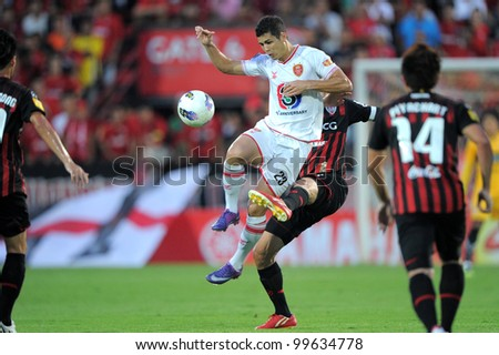 NONTHABURI THAILAND-March17:Cleiton Silva (W) of BEC Tero in action during Thai Premier League between SCG MuangThong utd.(R) and BEC Tero (W) on March17,2012 in SCG Stadium Nonthaburi,Thailand - stock photo