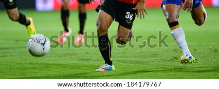 NONTHABURI THAILAND-MARCH 26:Detail of a player boots during  the Thai Premier League (TPL) between SCG MTUTD Utd vs ratchaburi fc on March 26,2014 at SCG Stadium in Nonthaburi Thailand