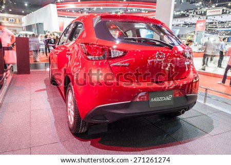 Nonthaburi,Thailand - March 26th, 2015: All New Mazda2 Sedan on display ,showed in Thailand the 36th Bangkok International Motor Show on 26 March 2015 - stock photo