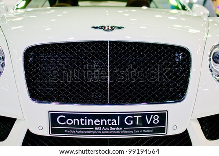 NONTHABURI, THAILAND - MARCH 28: The Bently car Continental GT V8 white model  in the 33rd Bangkok International Motor Show on March 28, 2012 in Nonthaburi, Thailand. - stock photo