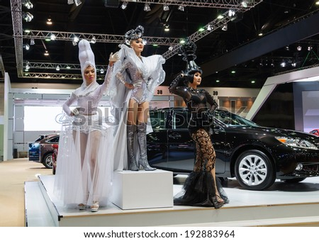 NONTHABURI, THAILAND - MARCH 31: Unidentified female models  with costume post at the Lexus Booth during the 35th Bangkok International Motor Show 2014 on March 31, 2014 in Nonthaburi, Thailand.