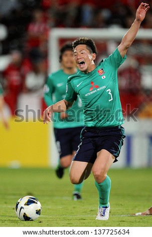 NONTHABURI,THAILAND-MAY01:Tomoya Ugajin of Urawa Red Diamonds in action during the AFC Champions League between Muangthong Utd.and Urawa Red Diamonds at SCG Stadium on May1,2013 in,Thailand.