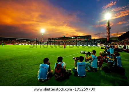 NONTHABURI THAILAND-May 17:Unidentified photographer and view of SCG Stadium during Thai Premier League Muangthong utd. and Chonburi F.C. at SCG Stadium on May 17,2014 in Thailand - stock photo