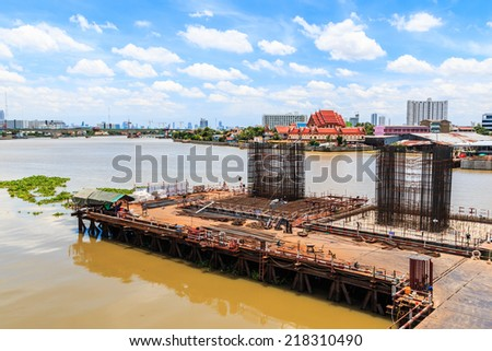NONTHABURI -THAILAND - SEPTEMBER 4 : Concrete bridge across Chao phraya river under-construction of its deep long pile foundation on September 4, 2014 in Nonthaburi, Thailand
