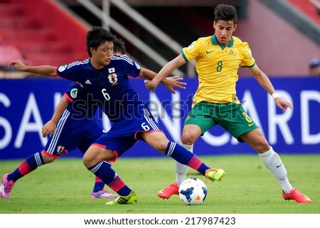 NONTHABURI THAILAND-SEPTEMBER 10:Daniel Arzain #8 (yellow)of Australia in action during the AFC U-16 Championship between Australia and Japan at Muangthong Stadium on Sep10 ,2014,Thailand