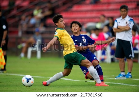 NONTHABURI THAILAND-SEPTEMBER 10:Doan Ritsu #6 (blue)of Japan in action during the AFC U-16 Championship between Australia and Japan at Muangthong Stadium on Sep10 ,2014,Thailand