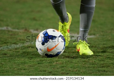 NONTHABURI THAILAND-SEPTEMBER 17:foot in close up of soccer cleats  during the AFC U-16 Championship between Australia and DPR Korea at  Rajamangala Stadium on Sep17,2014,Thailand - stock photo