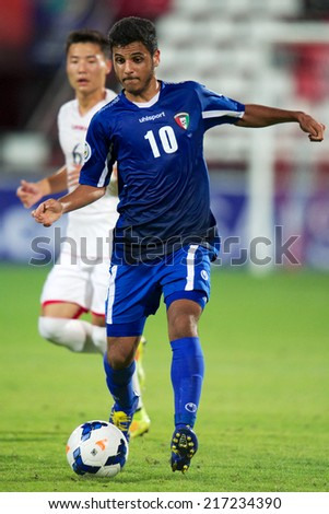 NONTHABURI THAILAND-SEPTEMBER 07:Meshal F A M Alsulaili (blue)of Kuwait in action during the AFC U-16 Championship between Kuwait and DPR Korea at Muangthong Stadium on Sep 07, 2014 ,Thailand