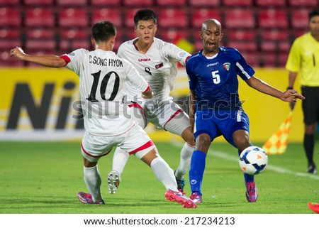 NONTHABURI THAILAND-SEPTEMBER 07:Naser S M S Saeed (R)of Kuwait in action during the AFC U-16 Championship between Kuwait and DPR Korea at Muangthong Stadium on Sep 07,2014,Thailand