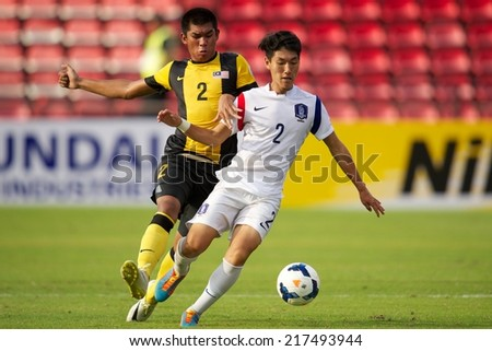NONTHABURI THAILAND-SEPTEMBER 08:Park Myeong Su (R) of Korea Republic in action during the AFC U-16 Championship Korea Republic and Malaysia at Muangthong Stadium on Sep08,2014,Thailand