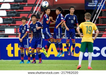 NONTHABURI THAILAND-SEPTEMBER 10:Players  of Japan (blue) in action during the AFC U-16 Championship between Australia and Japan at Muangthong Stadium on Sep10 ,2014,Thailand - stock photo