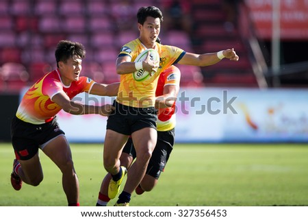 NONTHABURI THAILAND-SEPTEMBER 26:Unidentified rugby players in action during The Singha Thailand Sevens 2015 between Thailand (yellow) and China (rad) at SCG Stadium on Sep 26, 2015,Thailand