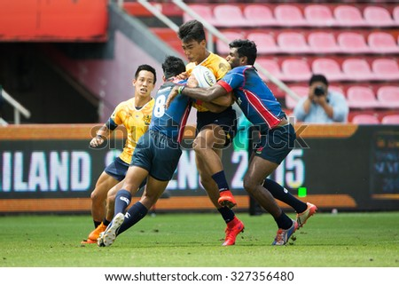 NONTHABURI THAILAND-SEPTEMBER 26:Unidentified rugby players in action during The Singha Thailand Sevens 2015 between Thailand (yellow) and Malaysia (blue) at SCG Stadium on Sep 26, 2015,Thailand - stock photo
