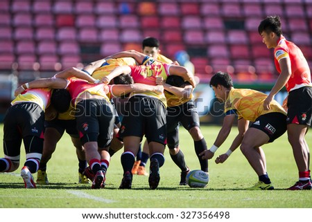 NONTHABURI THAILAND-SEPTEMBER 26:Unidentified rugby players in action during The Singha Thailand Sevens 2015 between Thailand (yellow) and China (rad) at SCG Stadium on Sep 26, 2015,Thailand - stock photo