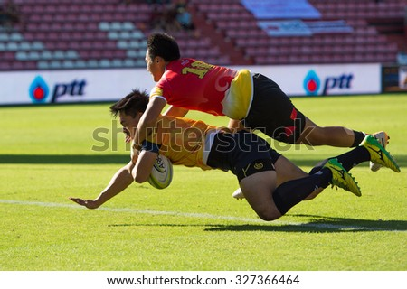 NONTHABURI THAILAND-SEPTEMBER 26:Unidentified rugby players in action during  The Singha Thailand Sevens 2015 between Thailand (yellow) and China (red) at SCG Stadium on Sep 26, 2015,Thailand - stock photo