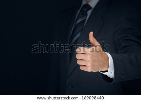 Nonverbal communication. Like, OK, perfect, good job, praise, satisfied, thumb up gesture of businessman.  - stock photo