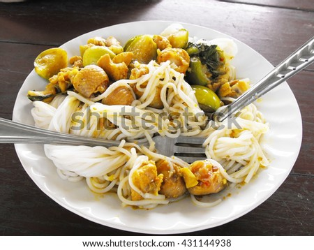 Noodle curry laksa in dish - stock photo