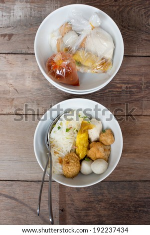 noodle in the bowl on wood floor - stock photo