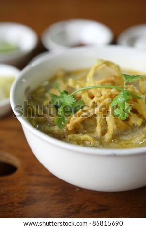 Noodle Khao soi , Thai food on wood background - stock photo