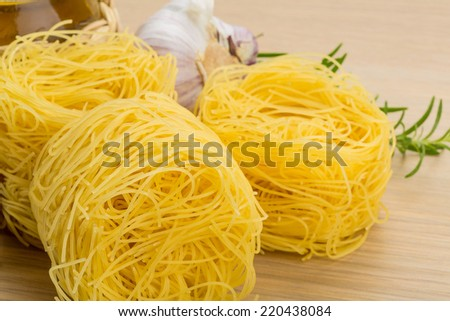 Noodle pasta with rosemary - stock photo