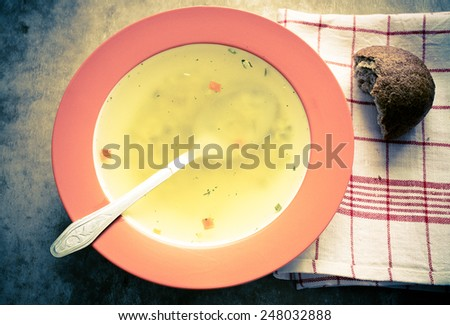 Noodle soup in a bowl with a spoon. Top view - stock photo