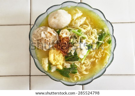 Noodle soup is finished and ready to be served - stock photo