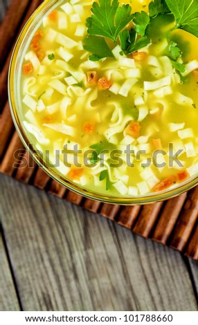 noodle soup on a wooden table - stock photo