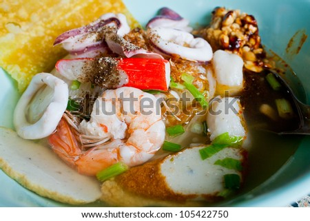 Noodle soup seafood in a bowl Thai food - stock photo