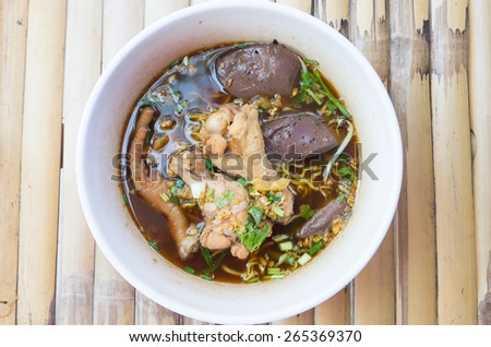 Noodle soup with vegetables and drumstick chicken. - stock photo