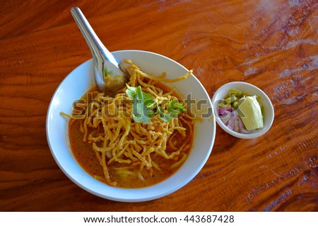 noodle with spicy coconut mile soup,  wood table, northern of Thailand
