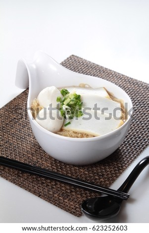 noodles in soup with meat and other ingredients