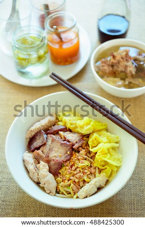 noodles with boiled pork,spicy soup