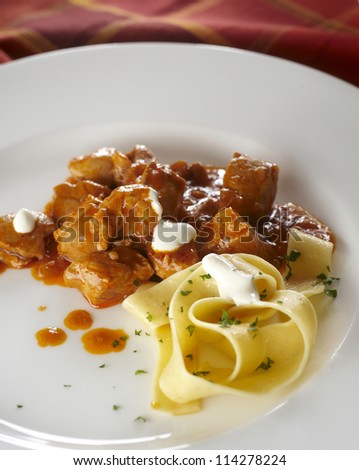 Noodles with goulash and cheese sauce - stock photo