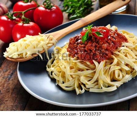 noodles with meat and salsa with tomato sauce