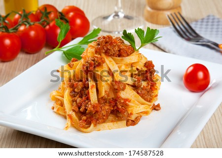 Noodles with meat sauce in a dish - stock photo