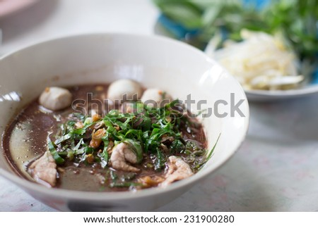 Noodles with pork and pork balls with soup Thai style. Thai peoples call Boat Noodles.. - stock photo