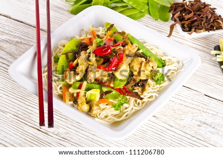 Noodles with pork and vegetables in plum sauce - stock photo