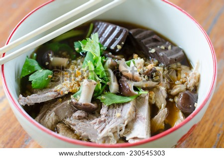 noodles with pot-stewed duck in bowl