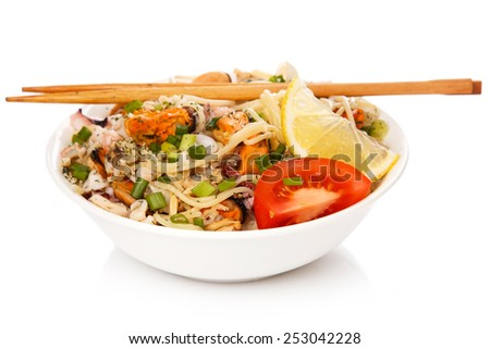 Noodles with seafood on white background - stock photo